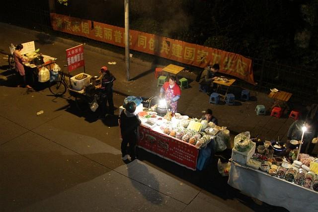 Street food stalls located beneath a Shanghai Metro station
