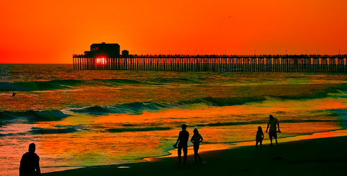 california family sunset red orange green pier nikon surf waves pacific surfer silhouettes oceanside stroll walkers topaz d90