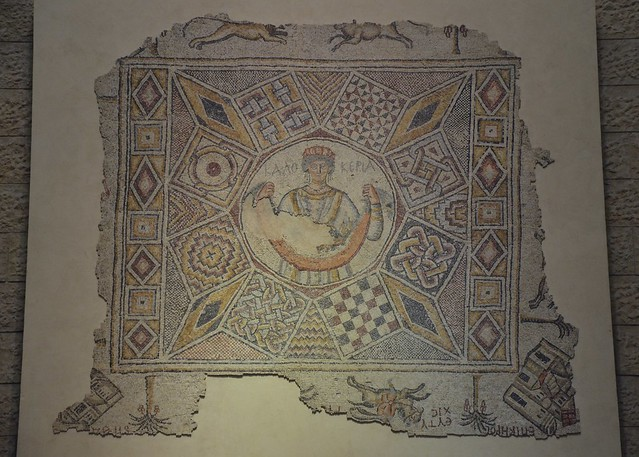 Mosaic from Caesarea decorated with animals, trees, geometric shapes, and in the center a woman holding a fruit basket, 6th century AD, Ben-Gurion airport mosaics