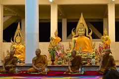 Evening ceremony with the monks in the temple in a village in Surin province, Thailand