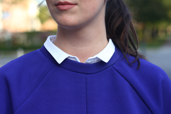 sweatshirt layered over collar