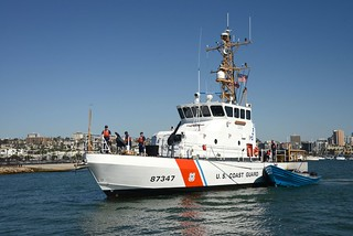The crew of U.S. Coast Cutter Haddock tows a seized panga boat into San Diego Bay, Oct. 2, 2014.  An estimated 1,200 pounds of marijuana was seized and two suspects were taken into custody in a multi-nation effort including the U.S., Mexico and Canada. (U.S. Coast Guard photo by Petty Officer 1st Class Henry G. Dunphy.)