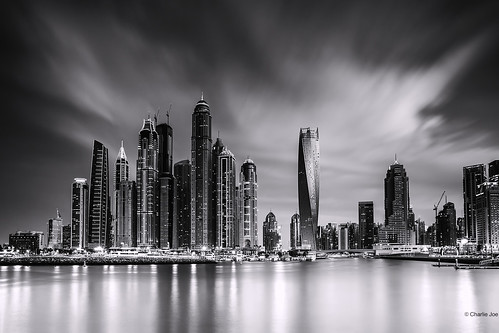 longexposure sunset bw seascape reflection monochrome skyline architecture night clouds lights blackwhite twilight dubai cityscape uae unitedarabemirates dubaimarina jumeirah tallest jbr princesstower cayantower