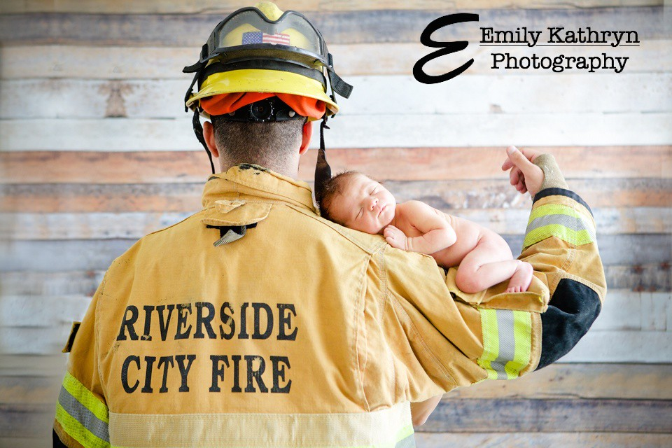 newborn and fire fighter