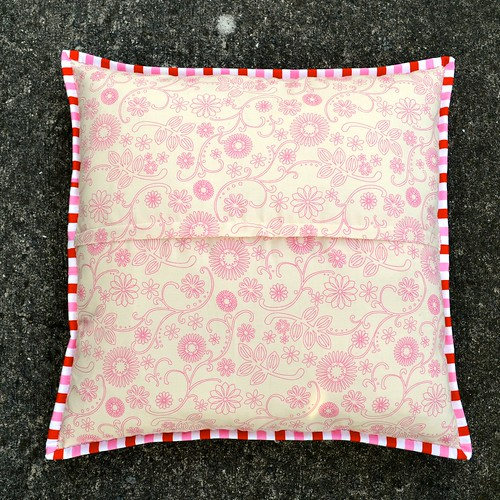 Pink, red and blue cushion