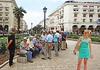 Macedonia, Thessaloniki, Aristotelous square, smiling girl in turquoise beach mood with retirees in backdrop #Μacedonia by gentle wolf