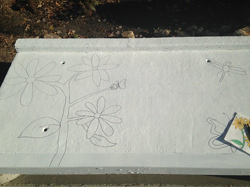 Image of the outline of a drawing on a storm drain.