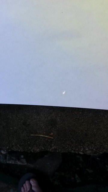 Partial eclipse viewed via pin hole