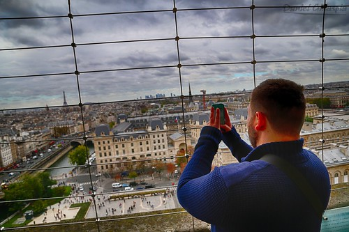 Man at top of Notre Dame tower