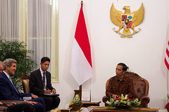 U.S. Secretary of State John Kerry sits with President Joko Widodo of Indonesia after he came to the Presidential Palace in Jakarta for a bilateral meeting following inauguration ceremonies for the newly sworn in leader on October 20, 2014. [State Department photo/ Public Domain]