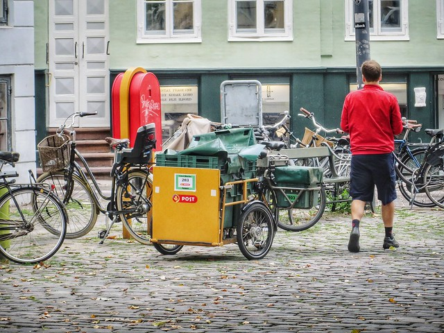 A Danish postman with his delivery bike