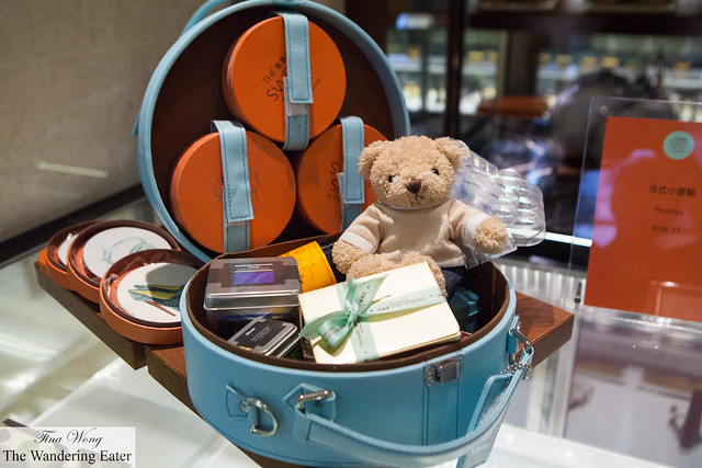 Gift basket items in a luxurious round leather box