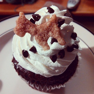 My honey surprised me with chocolate cream cupcakes, complete with tiny cinnamon dog shaped cookie toppers, from #WhoYouCallinCupcake #love #cupcake #dogs #delish