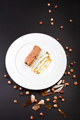 Chocolate Layer Cake with caramel, nuts and chocol…