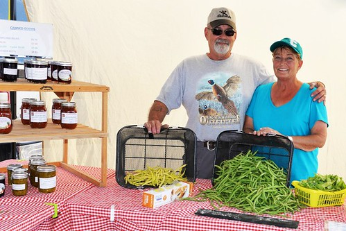Ernie and Terry Lehmkuhl of Springerridge Barnyard Products, organizers of the Country Farmer's Market in Pierre, SD, show off their products at a recent market.