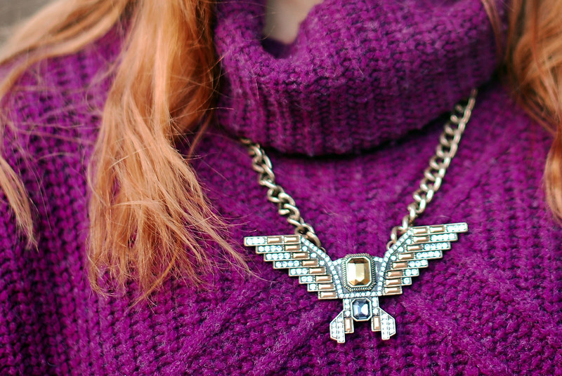 Purple knitwear and statement necklace