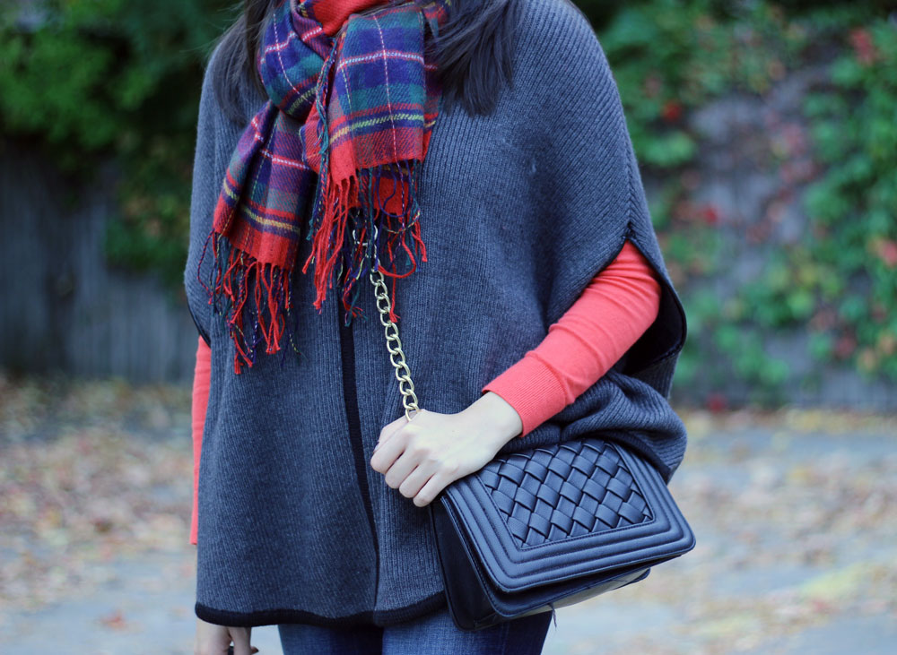 Gray poncho and red plaid scarf