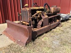 Aging Caterpillar D4 Bulldozer
