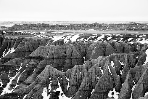rockformation sunrise winter overlook cloudy nationalpark ridges southdakota badlands rocks morning striations sedimentary butte layers cloudcover snow badlandsnationalpark spire panoramapoint pinnacle wall unitedstates us monochromatic blackwhite