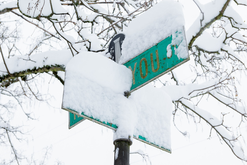 Snow covers all but the 'You' in the sign for Siskiyou Street