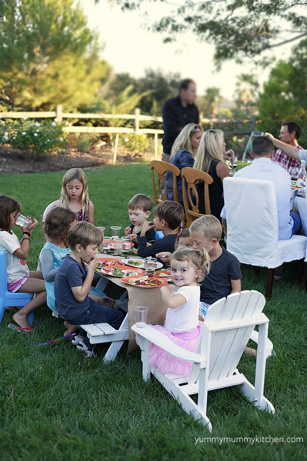 Kids at a backyard dinner party.