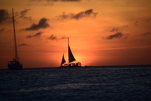 silhouettes silhouette aruba dutchcaribbean sunset sailboat paradise ocean caribbean islands island