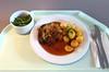 Pork steak (lumberjack steak) with red wine sauce, fried potatoes & onions / Holzfällersteak vom Schweinenacken mit Rotweinjus, Röstkartoffeln & geschmorten Zwiebeln
