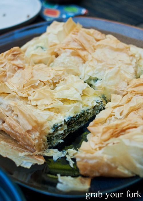 Cheese and spinach filling inside the spanakopita