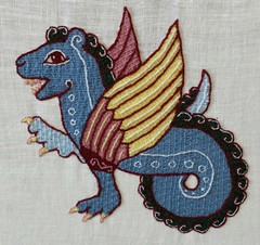 Stitch along dragon with finishing touches.