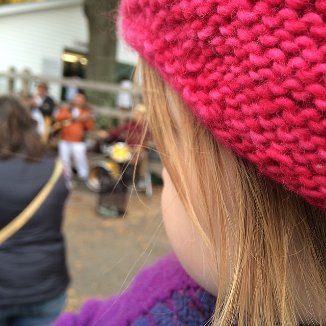 Listening to the music in mama's arms. She LOVES this pan flute band that plays at Rhinebeck every year.