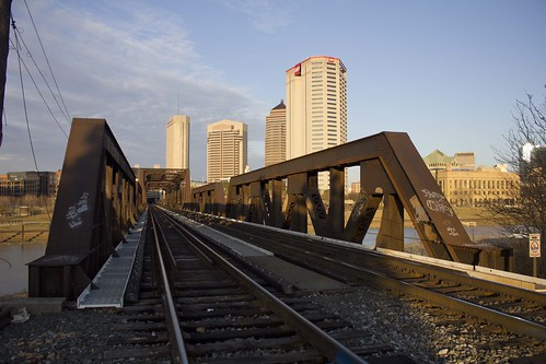 tracks city landscape chrispackart buildings skyline sun setting sunset photography