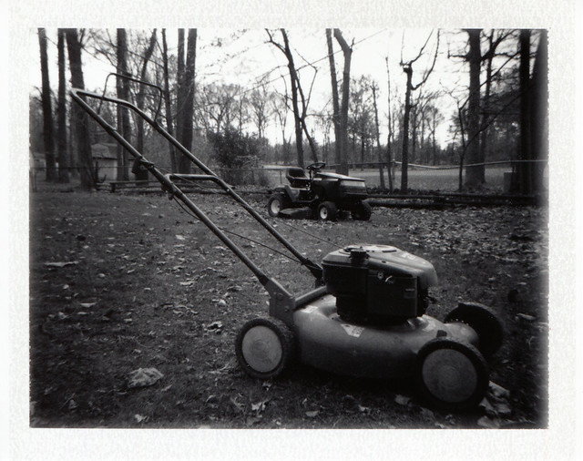 Push Mower with Tractor in the Background