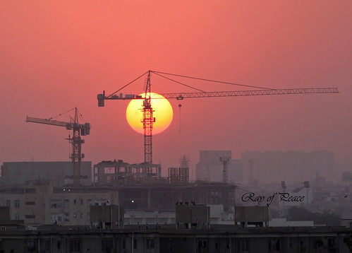 pakistan sunset orange sun love nature buildings golden site construction peace awesome cranes harmony karachi
