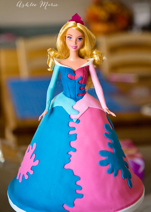 a full tutorial for a disney's aurora princess cake, a full multicolored splattered dress