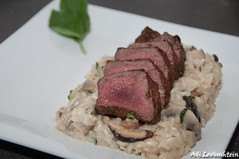 Beef fillet on a bed of mushroom risotto