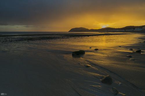 orange mountain beach wet weather rock wales sunrise sand rocks glow north llandudno orme