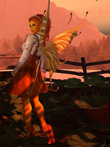 Image Description: Orange girl with orange hair and orange dress standing in a pumpkin patch.