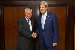 U.S. Secretary of State John Kerry greets Foreign Minister Albert del Rosario of the Philippines before a bilateral meeting after both attended the inauguration ceremonies for Indonesian President Joko Widodo in Jakarta, Indonesia, on October 20, 2014. [State Department photo/ Public Domain]