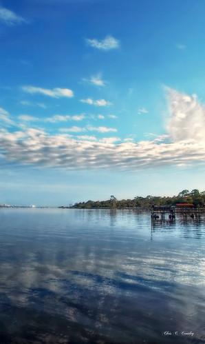 hemakesthecloudshischariot clouds sky river halifaxriver dock pier boat reflections scenic landscape amespark ormondbeachflorida