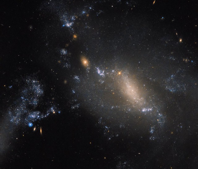Hubble Sees NGC 3447: 2 Galaxies in a Cosmic Dance Defy Conventions