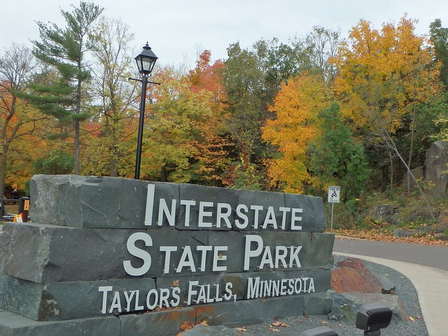 sign at the entrance of Interstate State Park, with colorful oaks in the background