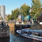 Obraz Rondvaart Canal. urban tourism amsterdam modern boat canal open busy rondvaart sluicegates
