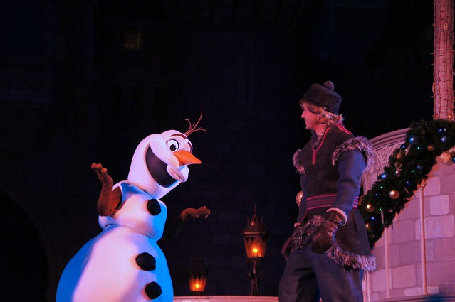 A Frozen Holiday Wish castle lighting stage show at Walt Disney World