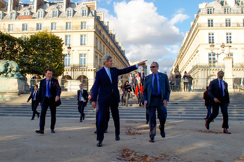 Secretary Kerry Points Toward Louvre Museum During Walk to French Foreign Ministry in Paris