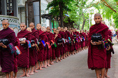 Monks lining up for food at monastary Mandalay