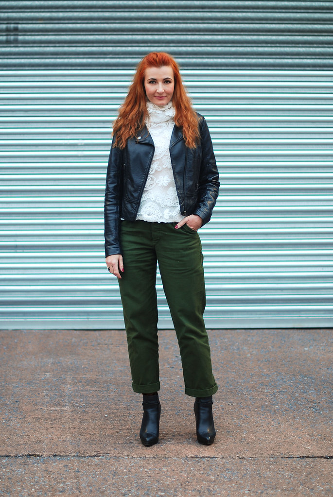 Biker jacket with white floral sweater and army green trousers