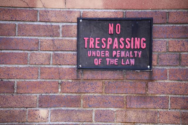 Pink No Trespassing Sign
