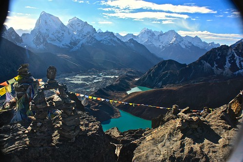 Prayer flags cut the Gokyo lakes at the top of Gokyo Ri
