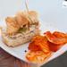 Pollo Rostizado (rotisserie chicken sandwich, quince, arugula, aioli) by Chef Seamus Mullen of El Colmado Butchery
