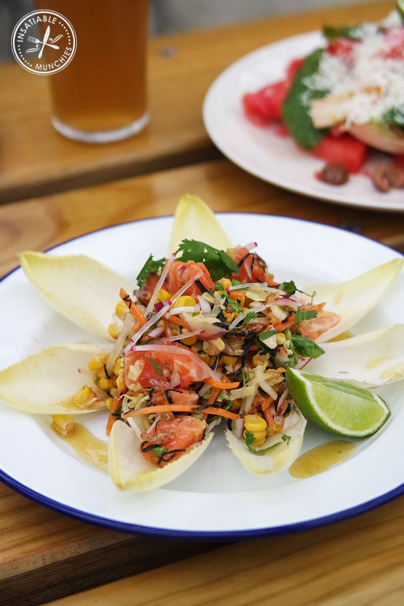 Ocean trout ceviche 'san choy bow', smoked corn, radish, ponzu, witlof cups, $18
